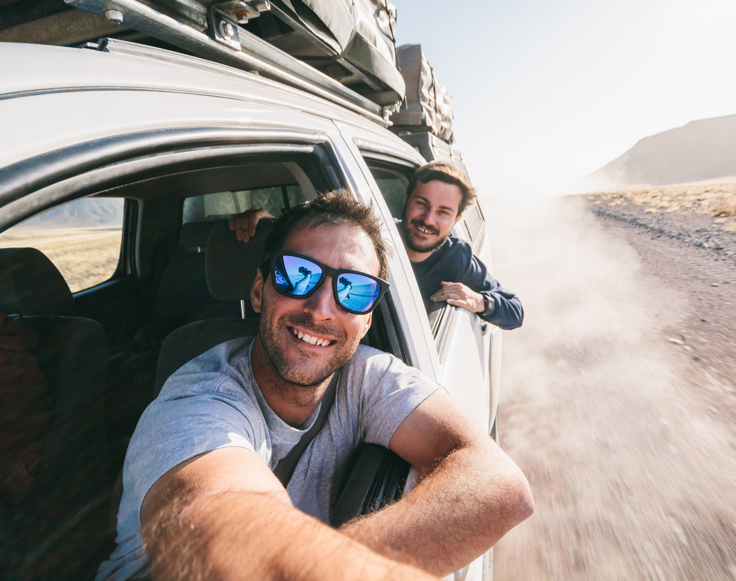 Adventure travel - Two young men taking a self portrait through